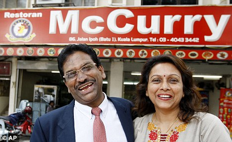 Owners of McCurry in front of their restaurant